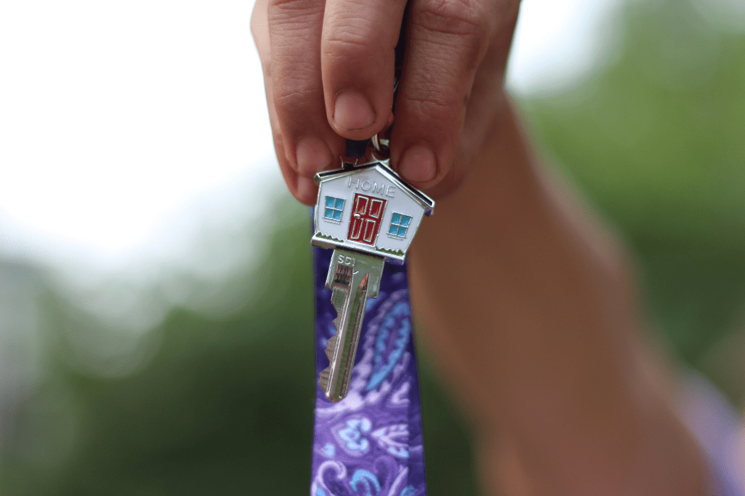 Rebecca holds the key to her family's new residence. (Photo by Lonny Goldsmith).